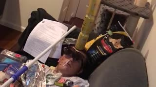 Man passed out with cans on face on couch - Video