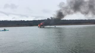 Kayak Rescues Fisherman from Burning Boat - Video