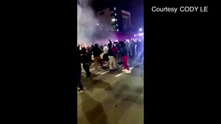 US police car charges crowd watching street race