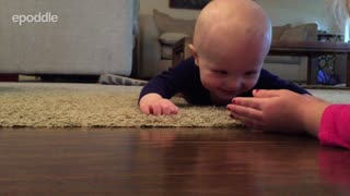 Baby laughs hysterically at rolling ping pong ball - Video