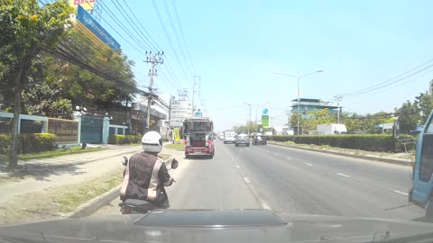 Close Call for Motorcyclist in Thailand