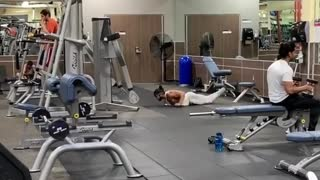 Dude works on his swimming strokes at the gym