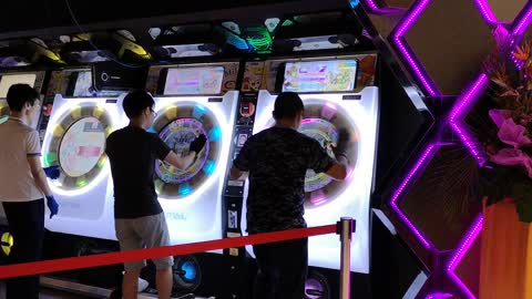 Kids play insane high-paced arcade game in Singapore mall