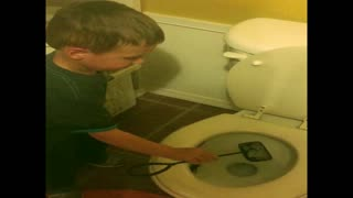 Boy puts fish in toilet but it's not dead - Video