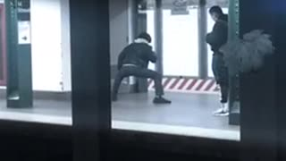 Guy stretches his legs at subway station
