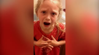 Little Girl Freaks Out Over Pulling Her Loose Tooth - Video