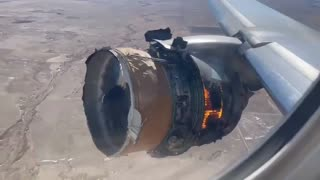 United Flight 328 Engine On Fire, Losing Pieces Over Denver