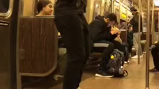 Man rapping on subway train