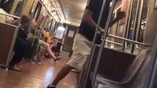 A man in black shirt hat growls like dog on subway - Video