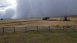 Squall Cloud Sweeps Across Field