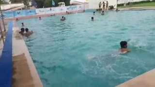 People enjoying on swimming pool   - Video