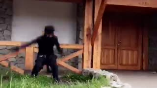 Guy dressed as ninja jumps off roof and fails - Video