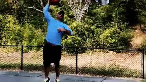 Man tries to slam dunk basketball into hoop and falls down, eminem song