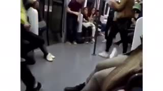 Man in subway uses hand handles to do flip but bumps head