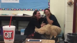 Woman Pranked By Life-Size Teddy Bear Costume at Staff Meeting - Video
