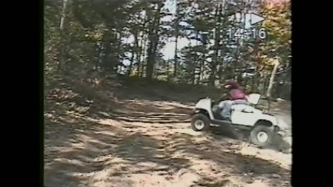Old Man Launches A Golf Cart Off Of A Hill And Falls Out
