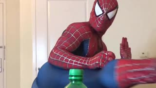 Spider-Man successfully attempts bottle cap challenge