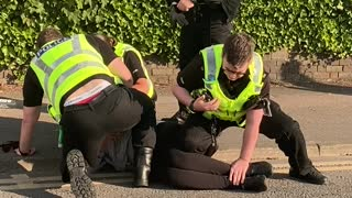 Multiple Police Takedown Woman in the Street
