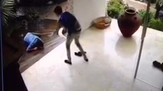 Security camera guy in blue slips on floor house