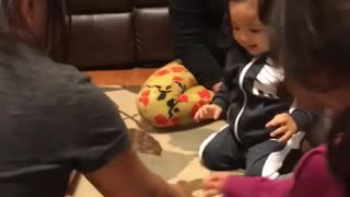 Toddler nails water bottle flip on his first try