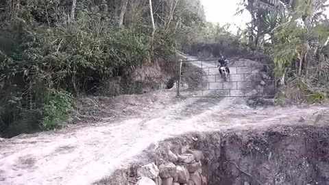 A motorcyclist avoids a barrier