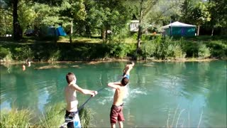 Slackline water stunt ends with epic faceplant - Video