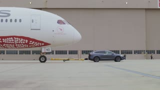 Tesla Model X Breaks Electric Tow Record After Pulling Boeing 787 Dreamliner - Video