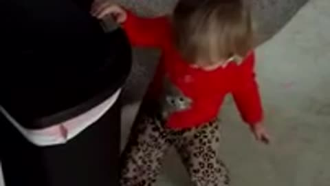 Toddler discovers joys of trash can