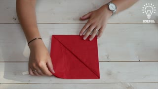 How to pocket-fold a napkin for dinner - Video