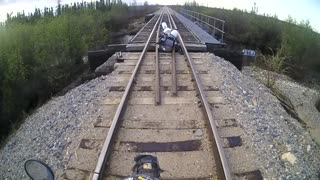 Motorcycle Falls Through Railroad Track - Video