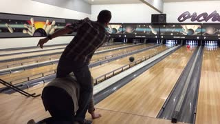 Straddle bowling trick shot. Strike! - Video