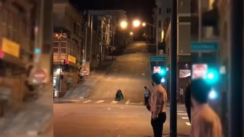 Dude Sliding A Hill Like A Boss On Trash Can