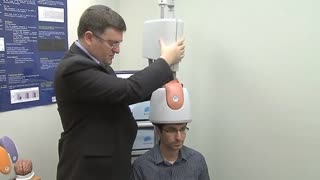 Brain Helmet Finds Pulse Of Depression Treatment - Video