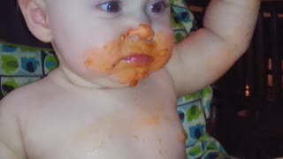 Baby girl makes gigantic mess of her lasagna