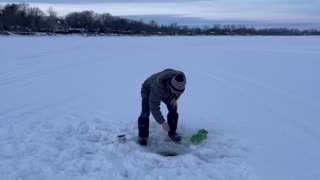 Canadian icefisherman catches smallest fish ever