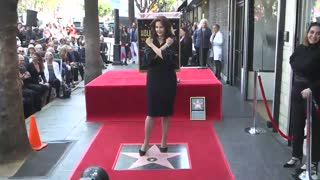 Lynda Carter Performs iconic poses during Walk of Fame Ceremony - Video