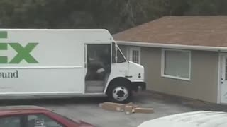Fedex guy launches boxes off truck - Video