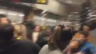 Dance music playing in subway station full of people