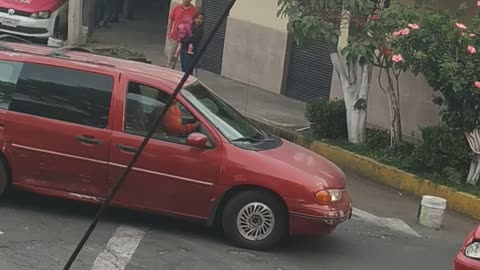Woman Smashes Car with Pipe after Accident