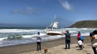 Tugging a Sailboat Off the Shore - Video