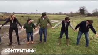 Group Of People Touch An Electric Fence - Video