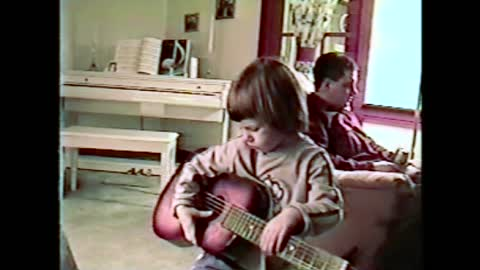 Little Guitarist Tries To Tune Her Guitar, Ends Up Hitting Mom In The Face