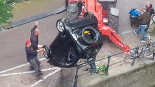 "Smart car pulled from Amsterdam canal after ""high-speed"" chase"