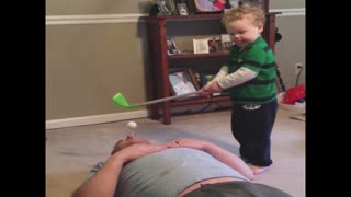 Kid fails to hit golf ball out dad's mouth - Video