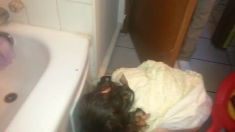 Toddler falls asleep on the training toilet. Funny