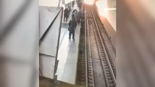 Woman On Phone Falls On Tracks As Tube Approaches