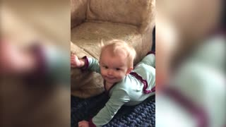 Baby Falls Off Couch While Drinking from Sippy Cup - Video