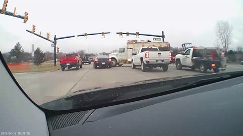 Watch this insane footage of a truck barreling through an intersection!
