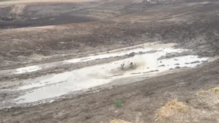 Rain Turns Dry Dam Into Outback Waterslide