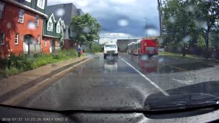 Driver Swerves into Puddle Splashing Pedestrian